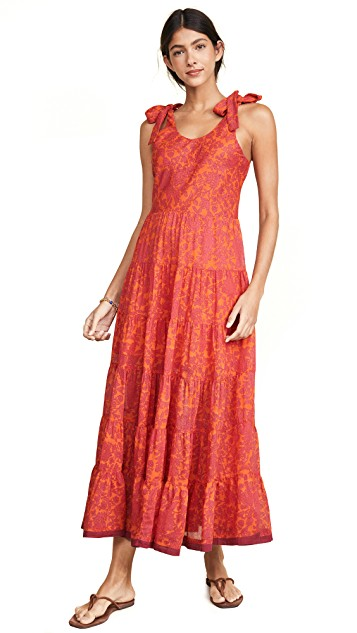 we adore the tangerine and hibiscus floral pattern on this  midi dress !
