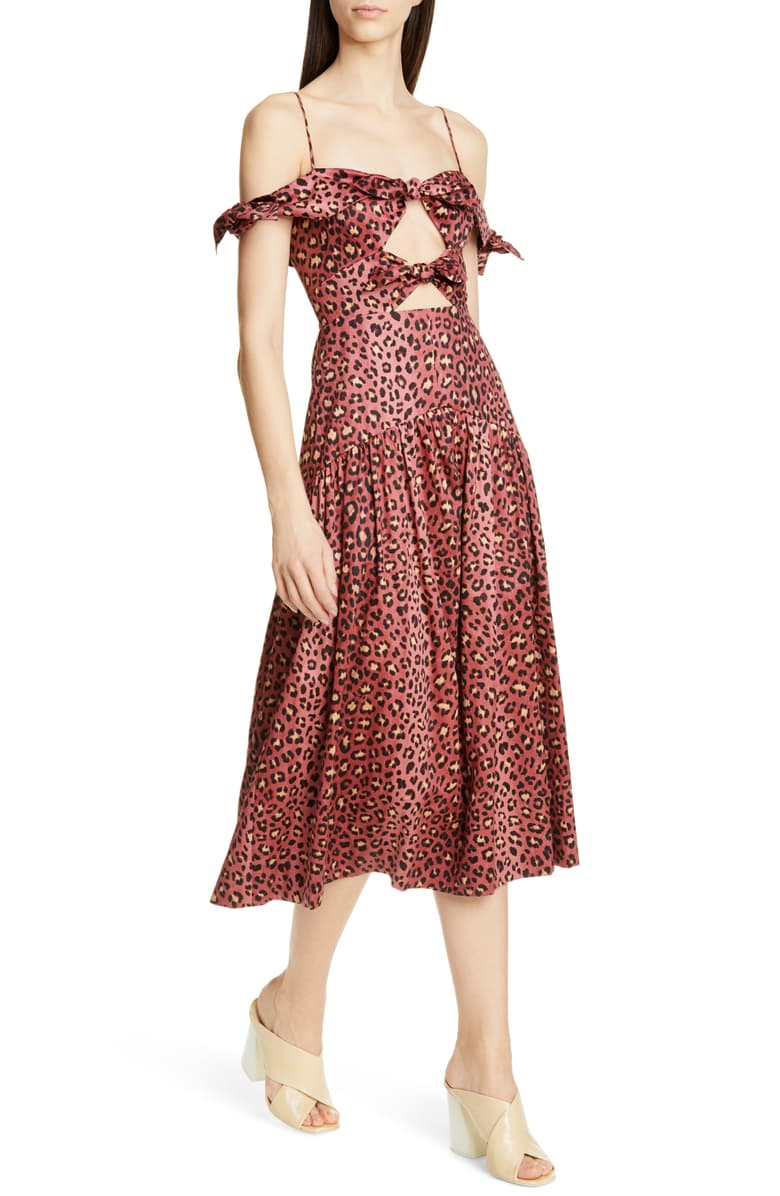 we're swooning over this  leopard print dress  with its peekaboo cutouts!