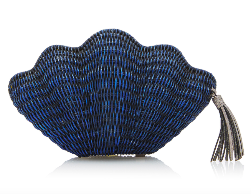 this  whimsical clam clutch  is at the top of our summer wishlist!