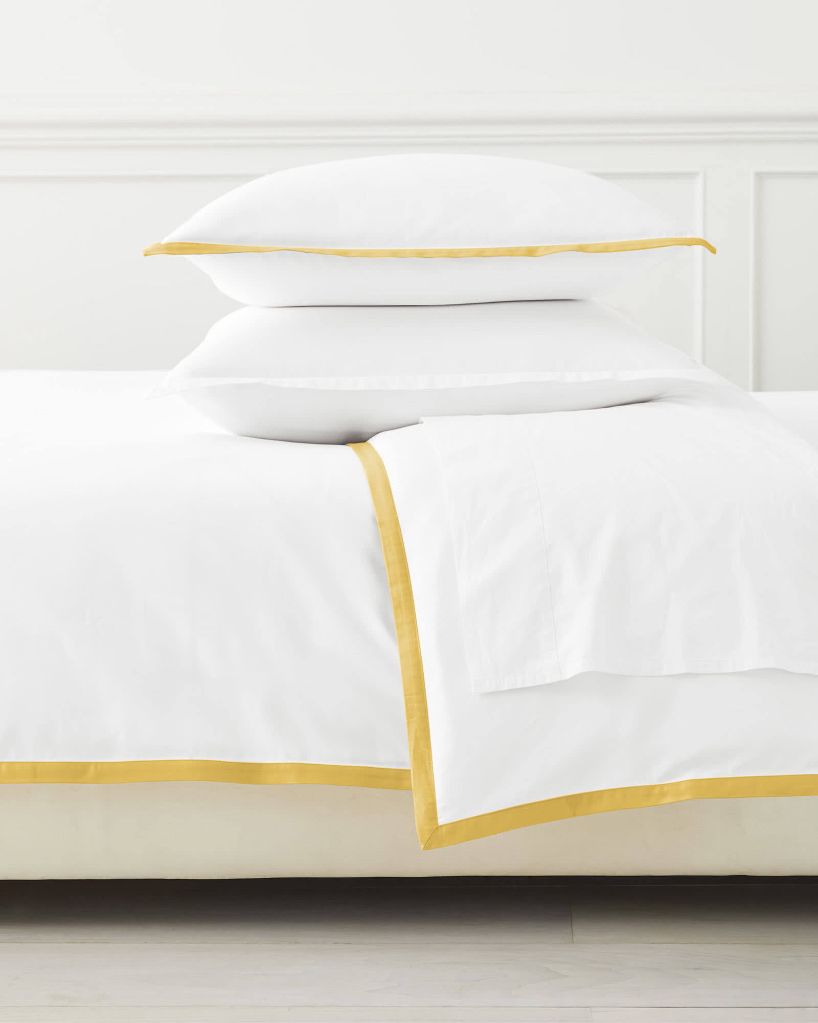 this  duvet cover  is a score at 30% off! the yellow border adds the perfect pop of color to any bedroom!