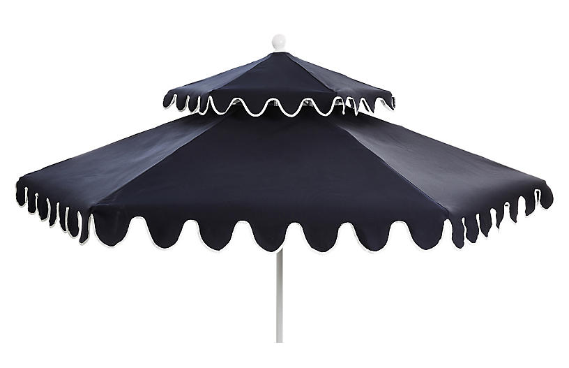 there are only a few left of our favorite  navy two-tiered outdoor umbrellas  left! don't miss out!