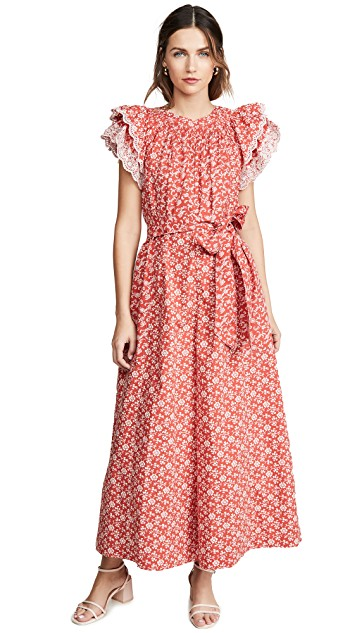 We are swooning over the ruffle sleeves on this adorable floral  red dress !