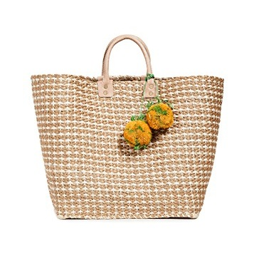 this  braided rope bag  stopped us in our tracks! and it comes in three happy colors!