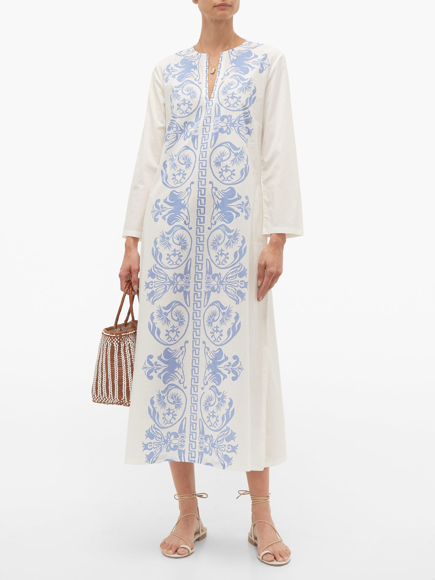 this  blue and white cotton poplin caftan  is at the tippy top of our wishlist!