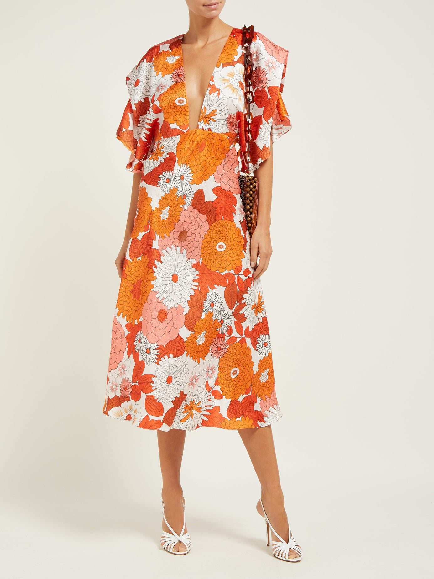 we love the bold print and plunging neckline on this  happy floral frock ! (and it's 50% off today!)