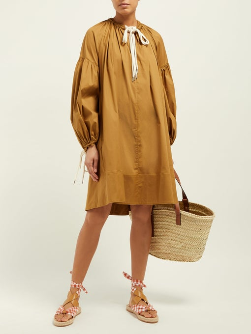 we are swooning over this  breezy tunic dress !