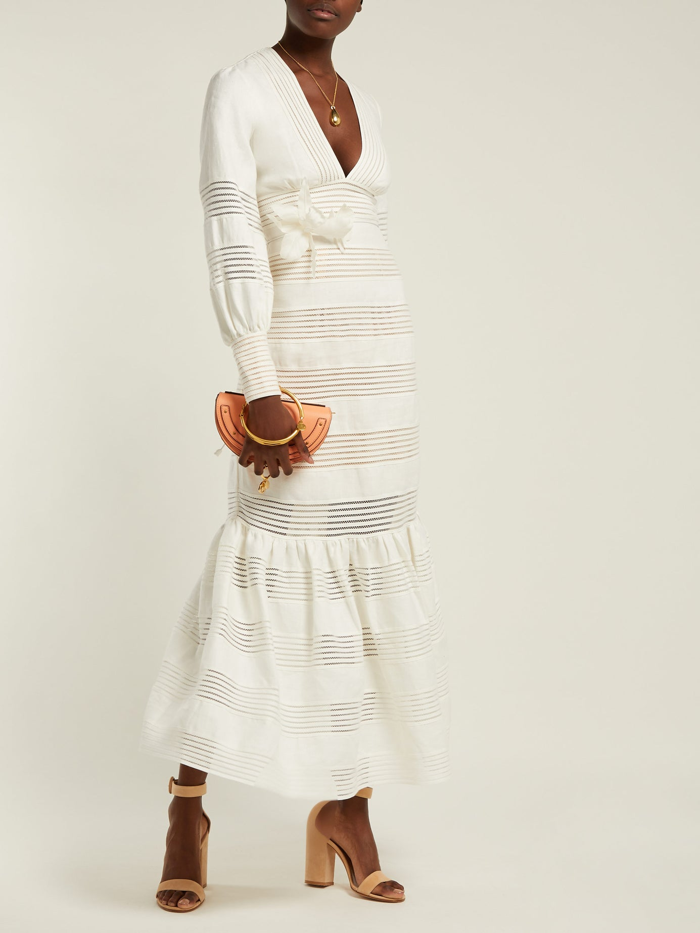 this  splurge-worthy midi dress  is at the tippy top of our wishlist!