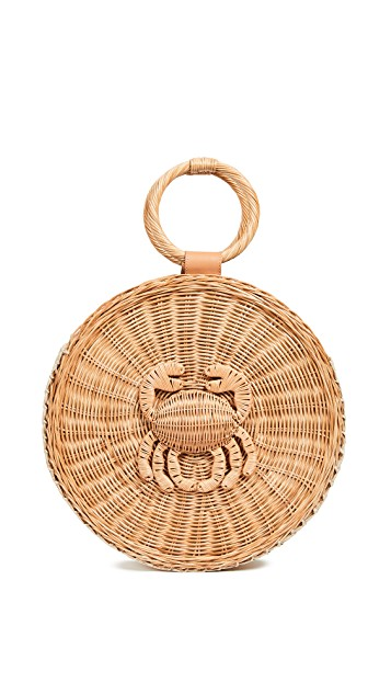 we're crushing on this  whimsical straw bag !