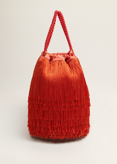make a statement with this  fringe bucket bag … under $100!