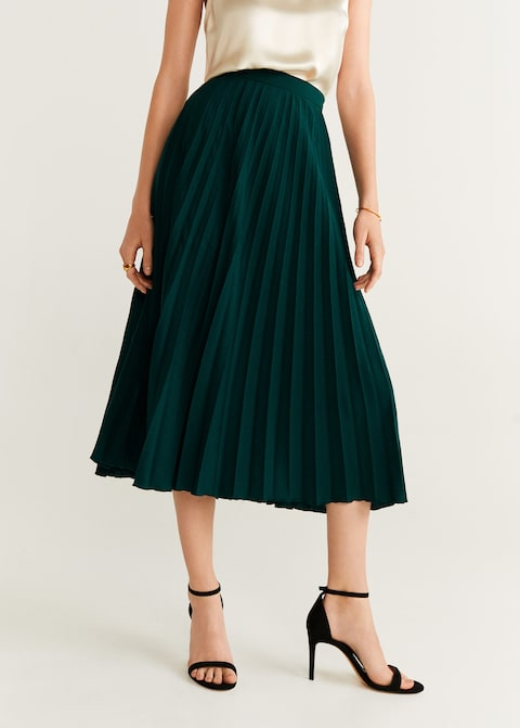 we're swooning over this  pleated skirt  in the prettiest emerald green! p.s. snap it up for under $60!