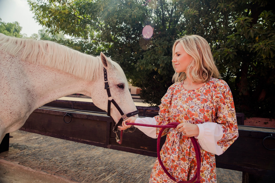 how darling does tory burch look in this  dainty floral patterned drop waist dress ?