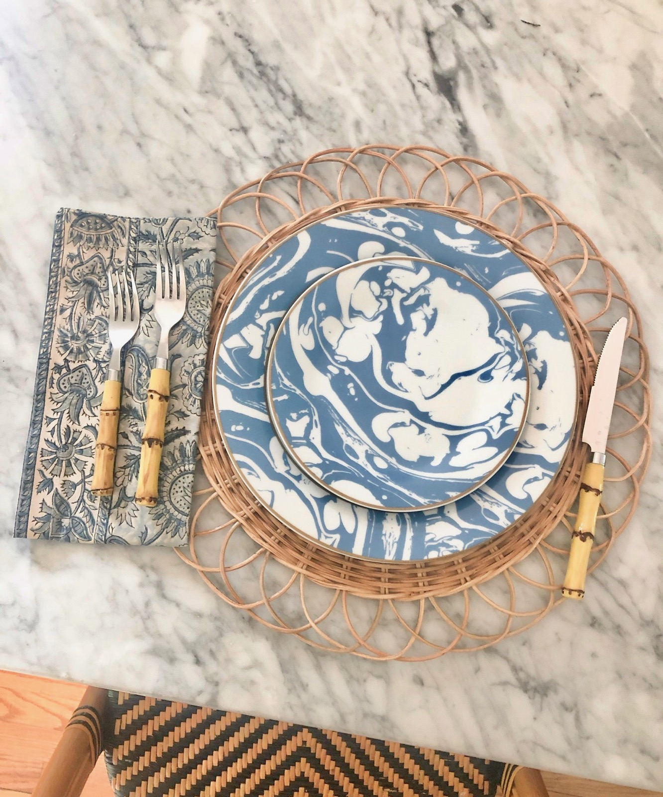 we're loving our new  blue + white marble swirl dinnerware  paired with classic  bamboo flateware !