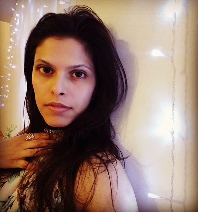 Yes I'm listening #mood . . . . . . . . . . . . #brunette #floralprint #longhair #hairvolume #choker #haltertop #flashinglights #saturdaynight #darkeyes #stopstaring #deepeyes #staring #mixedrace #multiethnic #australianactress #bangladeshi #actress #funnygirl #ring #sparkling #hand #jewelry #bottomlip #nomakeup #star #cheekbones #barelyawake #reachforthestars #pink