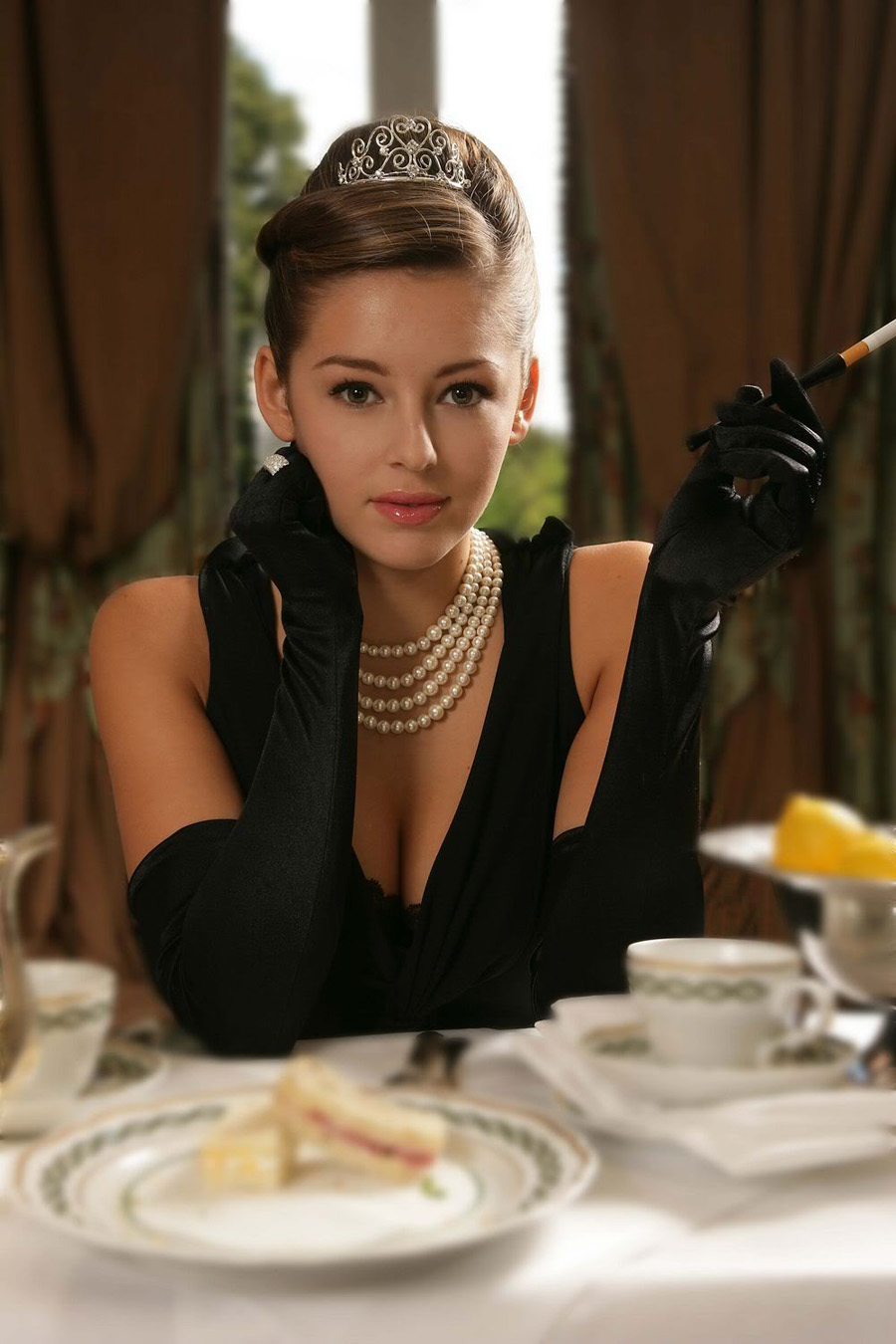 It is strange to see another British lingerie and nude model channeling her inner  Audrey Hepburn  and looking so great and natural. The look has a slightly cheaper feel because of the cut of the dress and its fabric, but  Keeley Hazell's  face is seductive and innocent at the same time, which saves it.