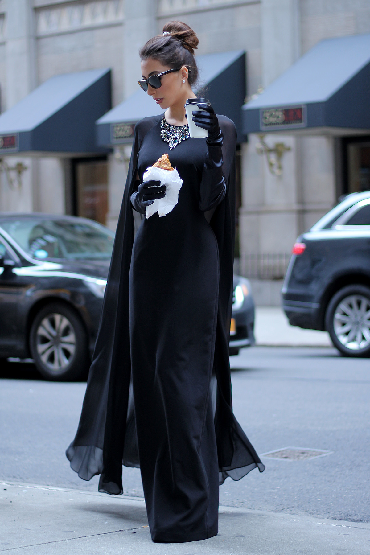 Black cape gown worn by Ulia Ali blogger for Breakfast at Tiffany look.