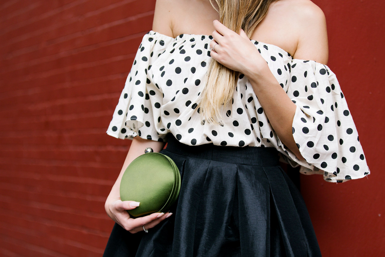 Blogger wearing Shein Polka dot top and macaron Kenzo bag