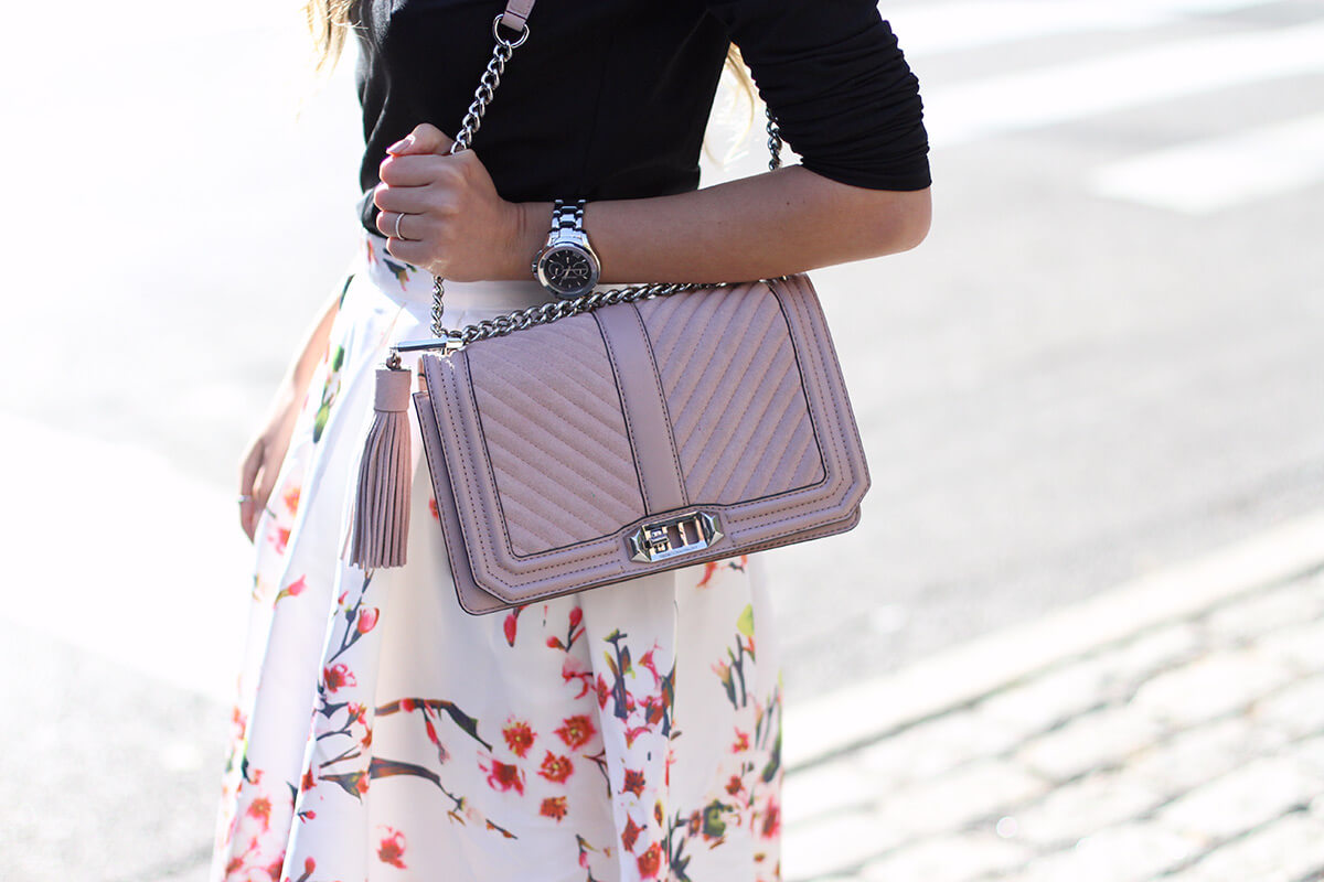 Rebecca Minkoff pink suede bag with a tassel.