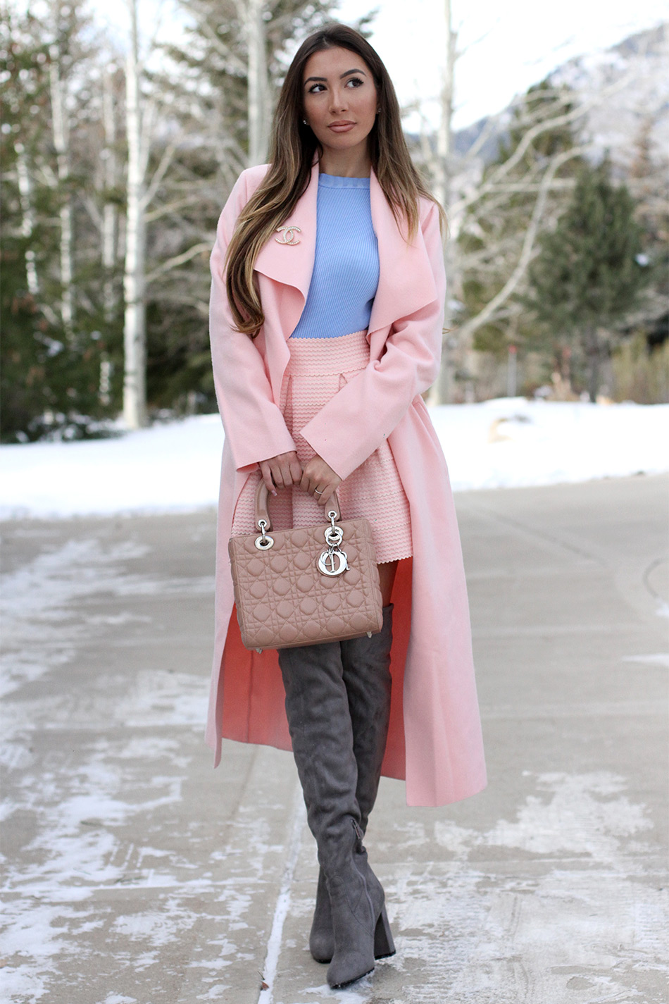 Winter look by Ulia Ali. Wearing long pink coat and grey Stuat Weitzman warm over the knee boots.