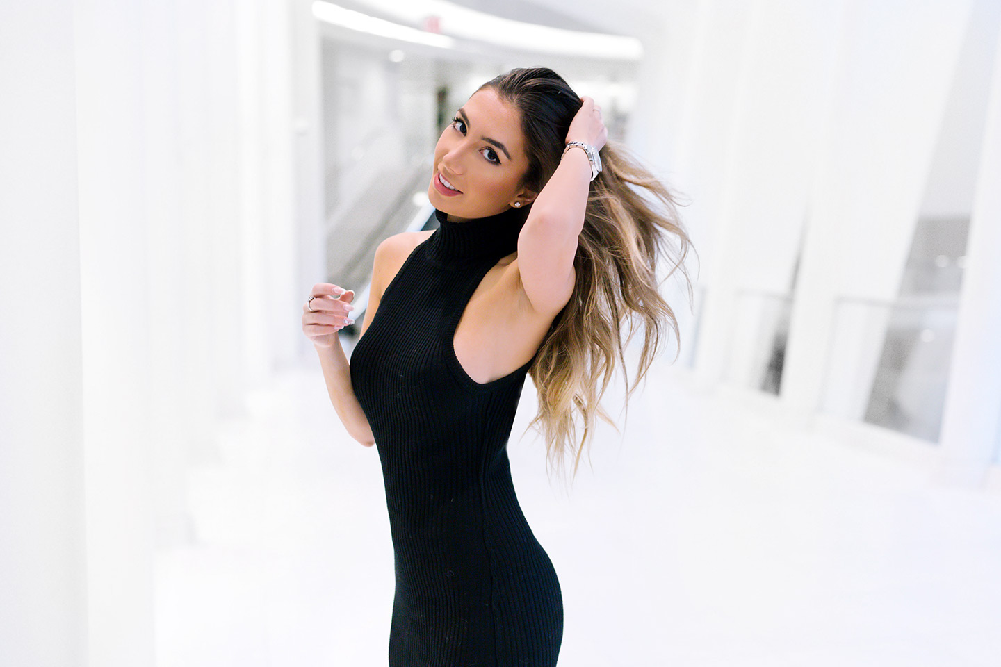 Black dress in White World Trade Center. Photoshoot in Oculus
