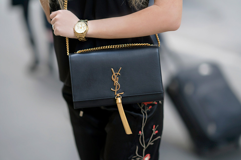 Black YSL bag with gold chain.