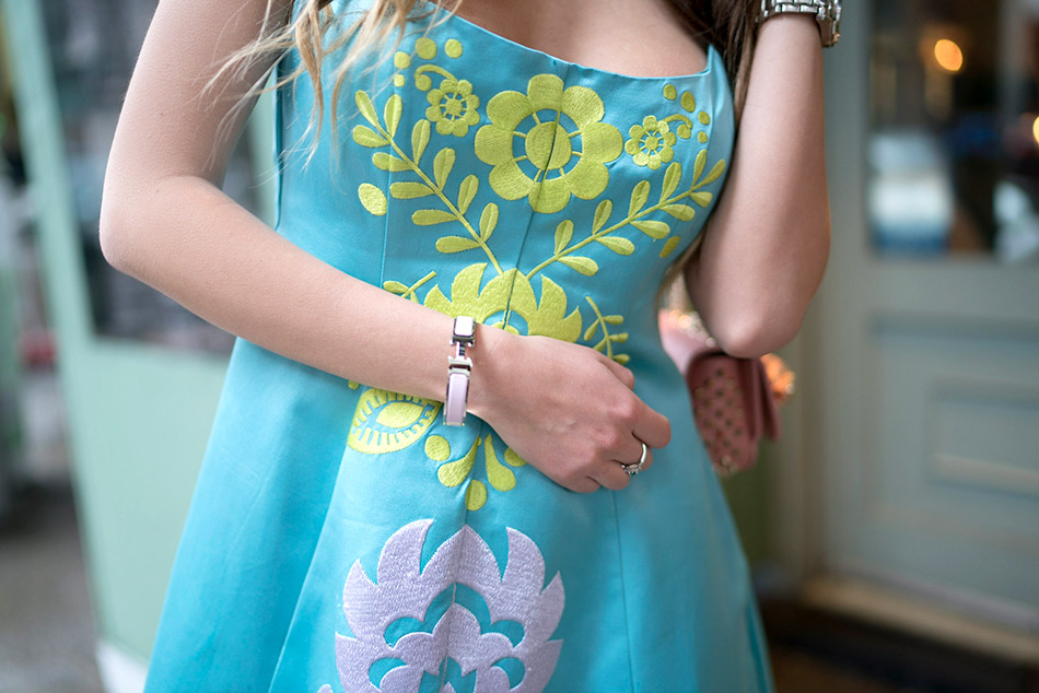 Blogger Ulia Ali in turquoise embroidered dress by Cynthia Rowley. Hermes pink bracelet.