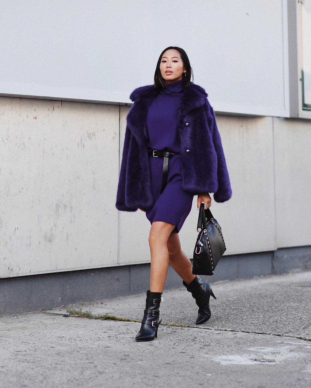 Iconic blogger  Aimee Song  from  @songofstyle  somehow fashionably survived the hot September weather in a fur coat, a warm dress and booties.