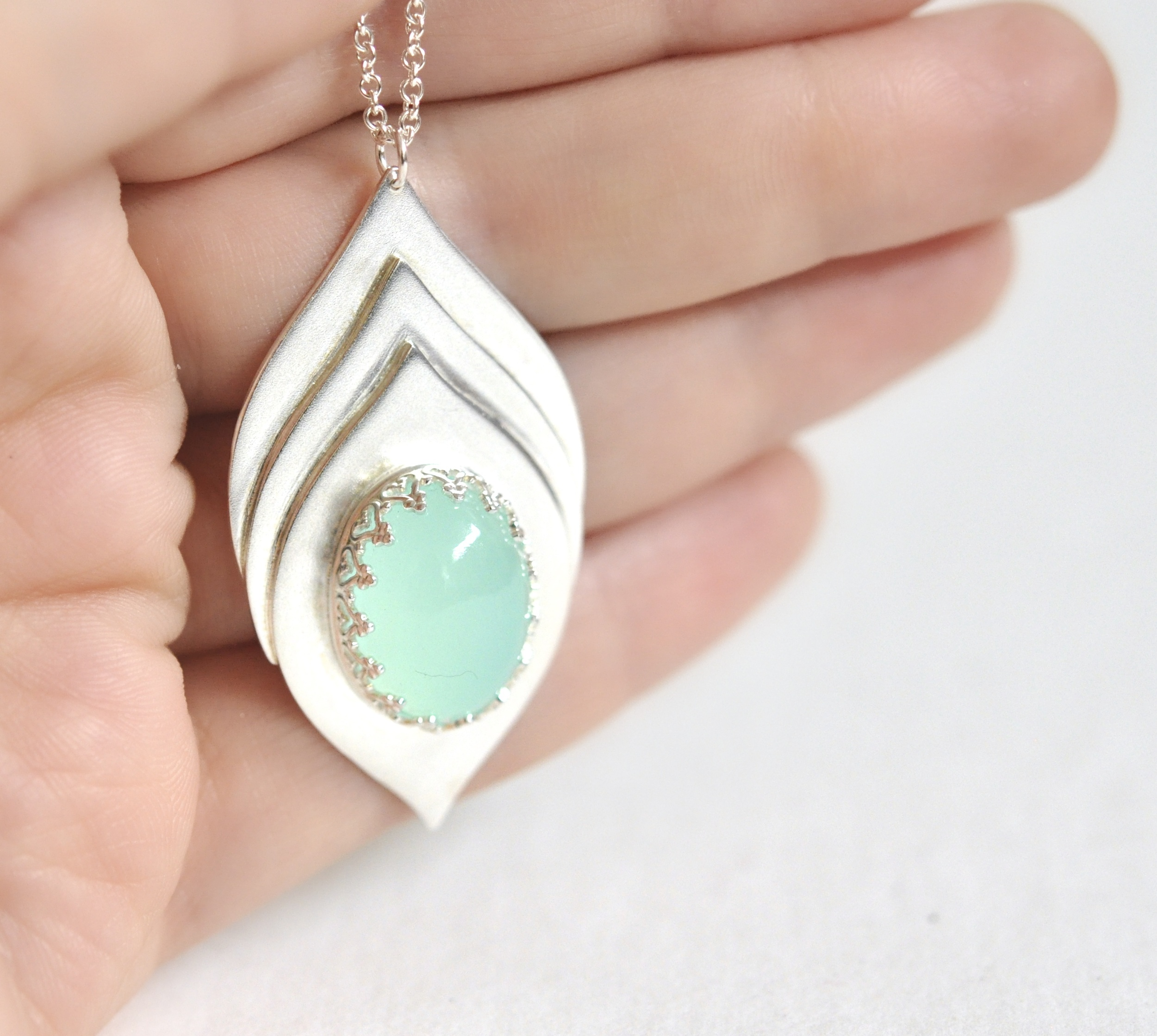 SSN Chalcedony oval 3 layer arch pendant.jpg