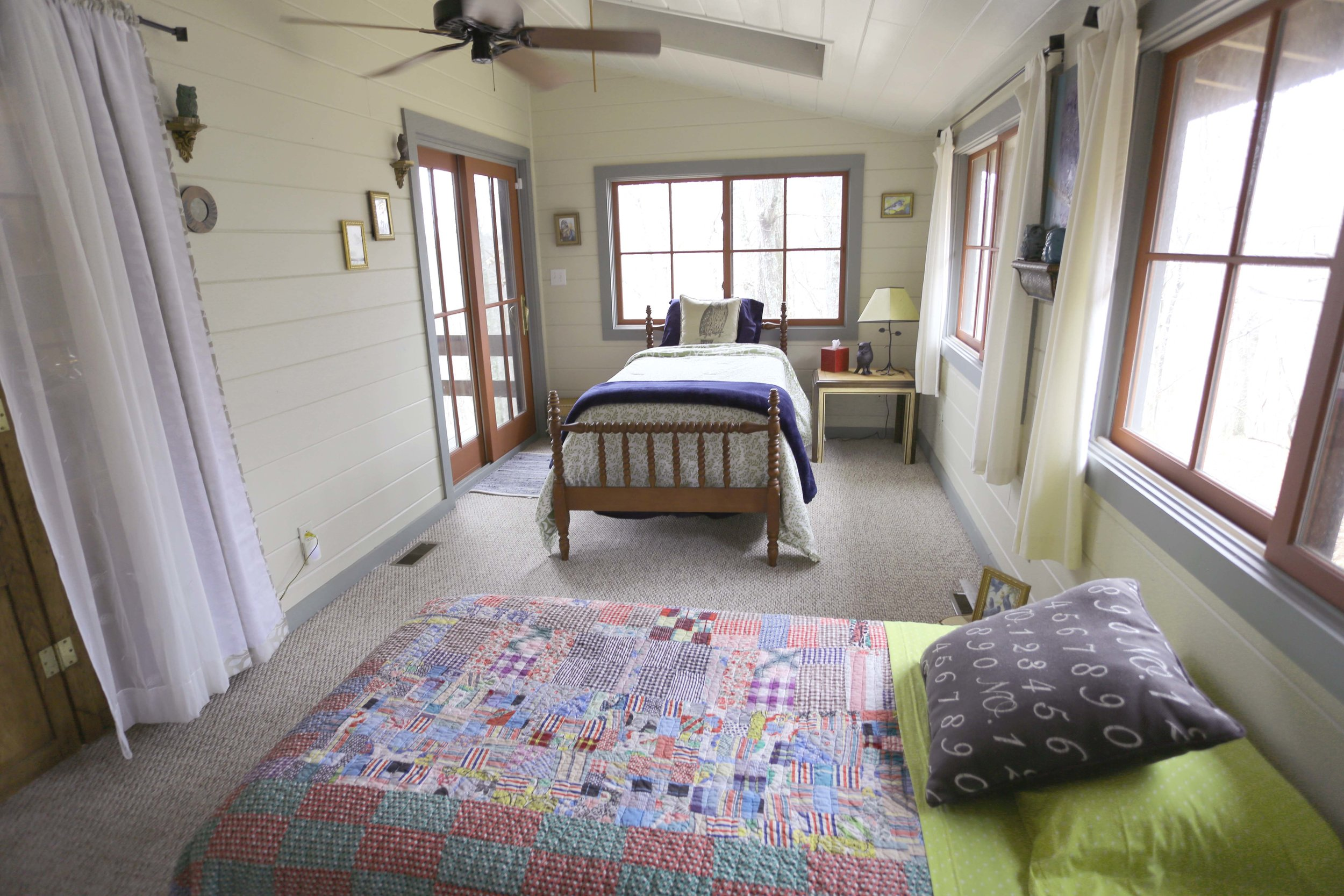The LakeTrail Sunroom contains two twin beds. It shares a bathroom either with the Master Bedroom (if in the same Party) or in the East Wing. $35/person* weekdays; $50/person* weekends.  *double occupancy.