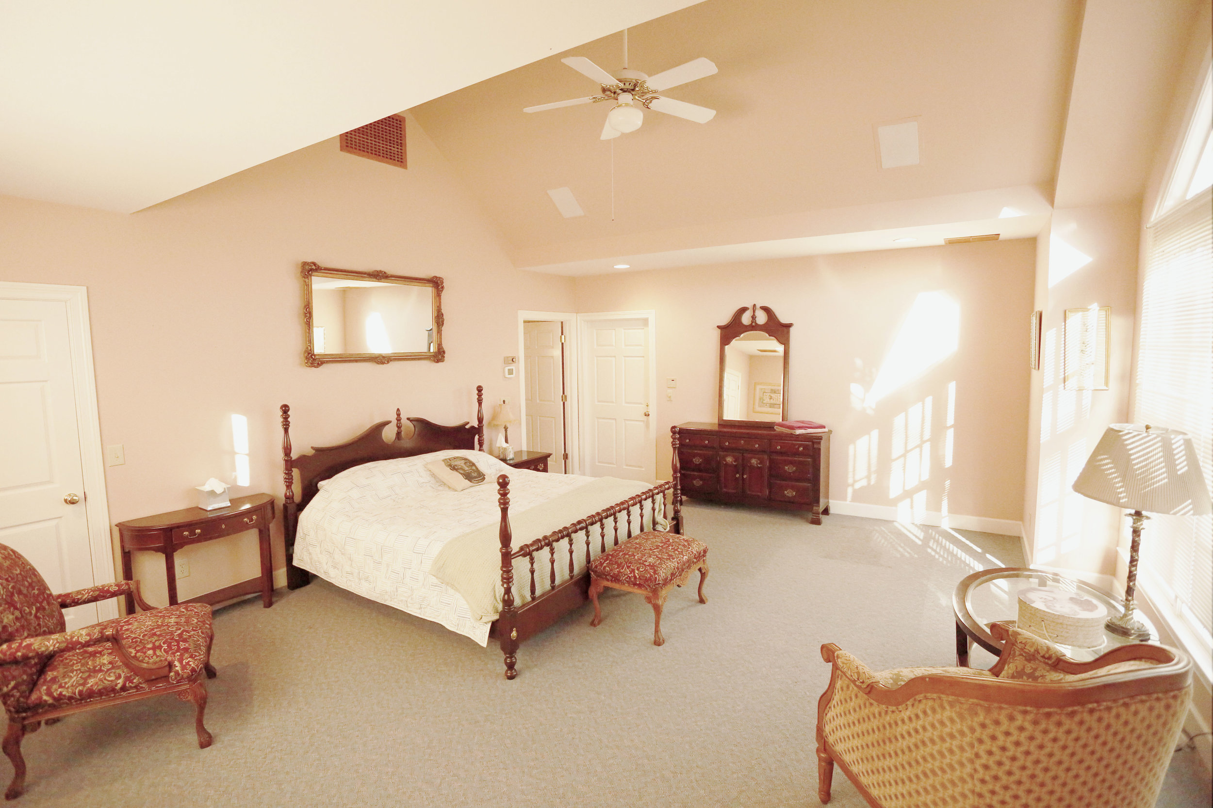 The Mansion GardenView Room shares a full bathroom with the Balcony Room. Additional full and a single beds may be added.