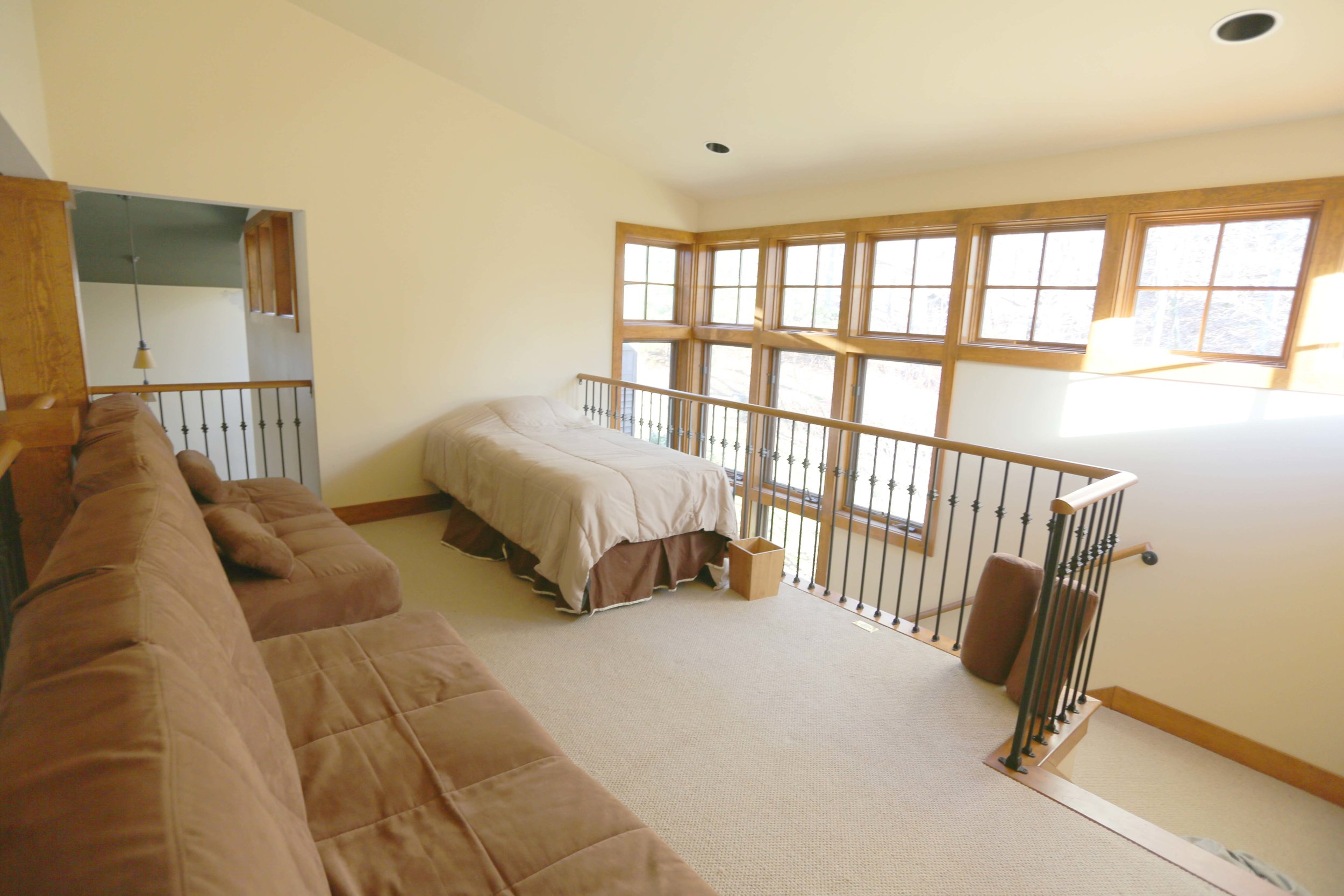 The Circle Lodge Main Loft has two queen futons and a single bed. Shared full bathroom downstairs Horseshoes, bocci, shuffleboard, fishing pond on site. Organic produce straight from farm steps away.