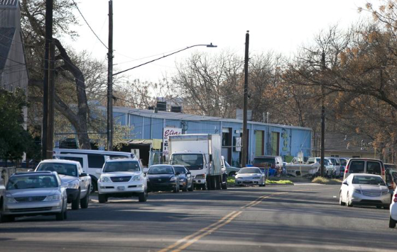 A look along Red Bluff Road, where developers want to put a hotel, replacing the blue warehouse and other businesses along the river's edge.