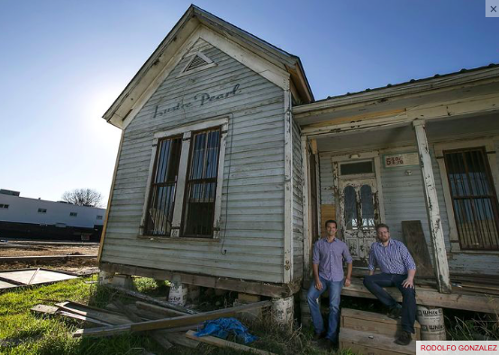 Rainey Ventures and its founders, Dale Glover, left, and Jesse Lunsford pose for a portrait on the front porch of the Lustre Pearl building on Tuesday, Feb. 10, 2015 in Austin. RODOLFO GONZALEZ / AMERICAN-STATESMAN