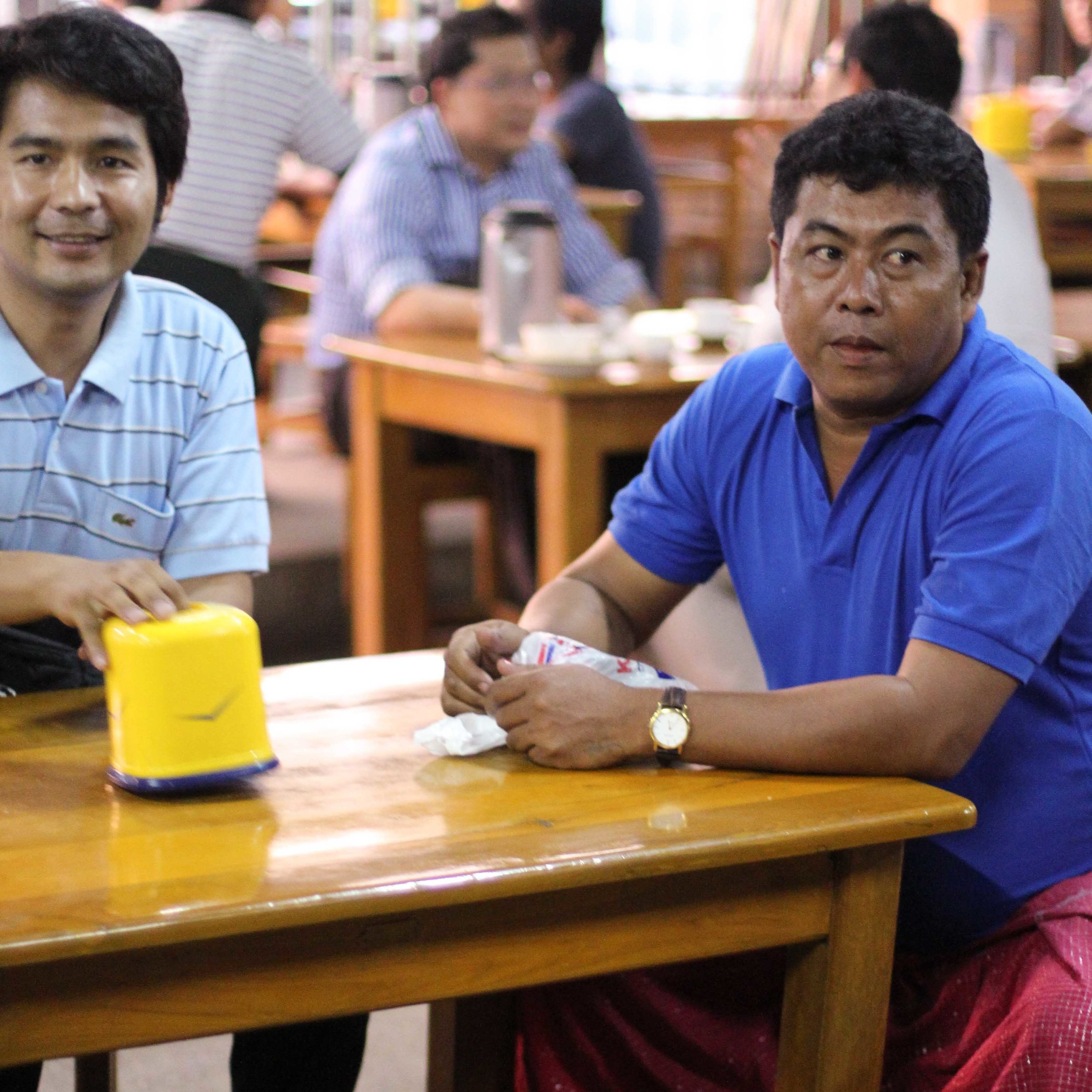 A popular tea shop in Yangon; the man on the right is an expert milk-tea maker and now travels to different tea shops training staff.