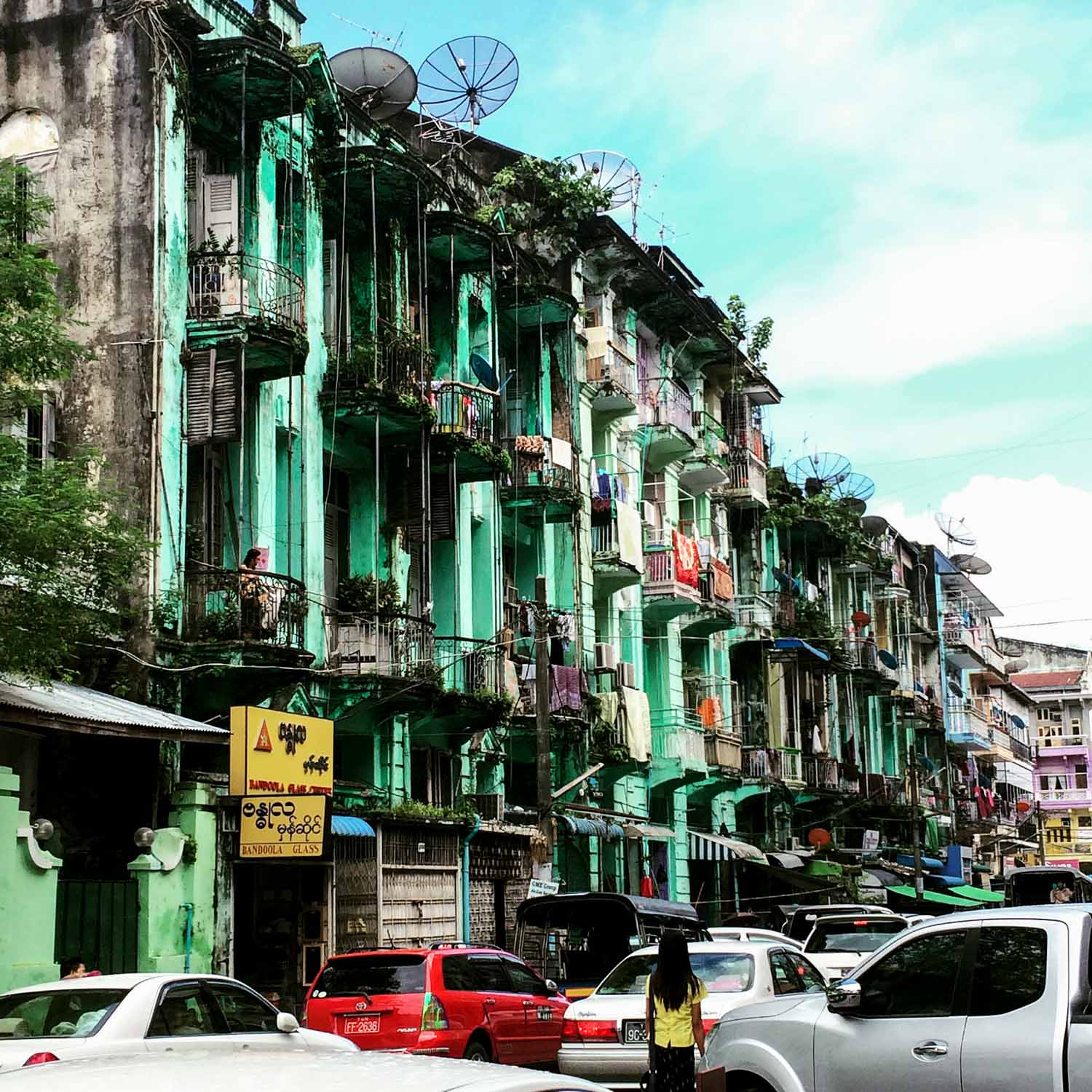 Yangon's colonial facades mix with gridlock