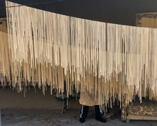 Hanging arishta, an Armenian pasta, out to dry. Better with tomato sauce than laundry.