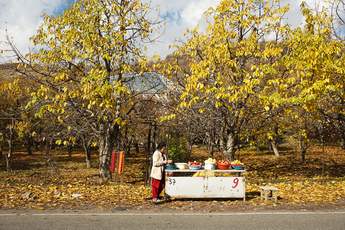 This was of the tail end of fall, when the leaves on the fruit orchards was just barely hanging on. This woman was doing her best to sell apples to tourists on their way back from Geghard Monastery before tourist season ended.