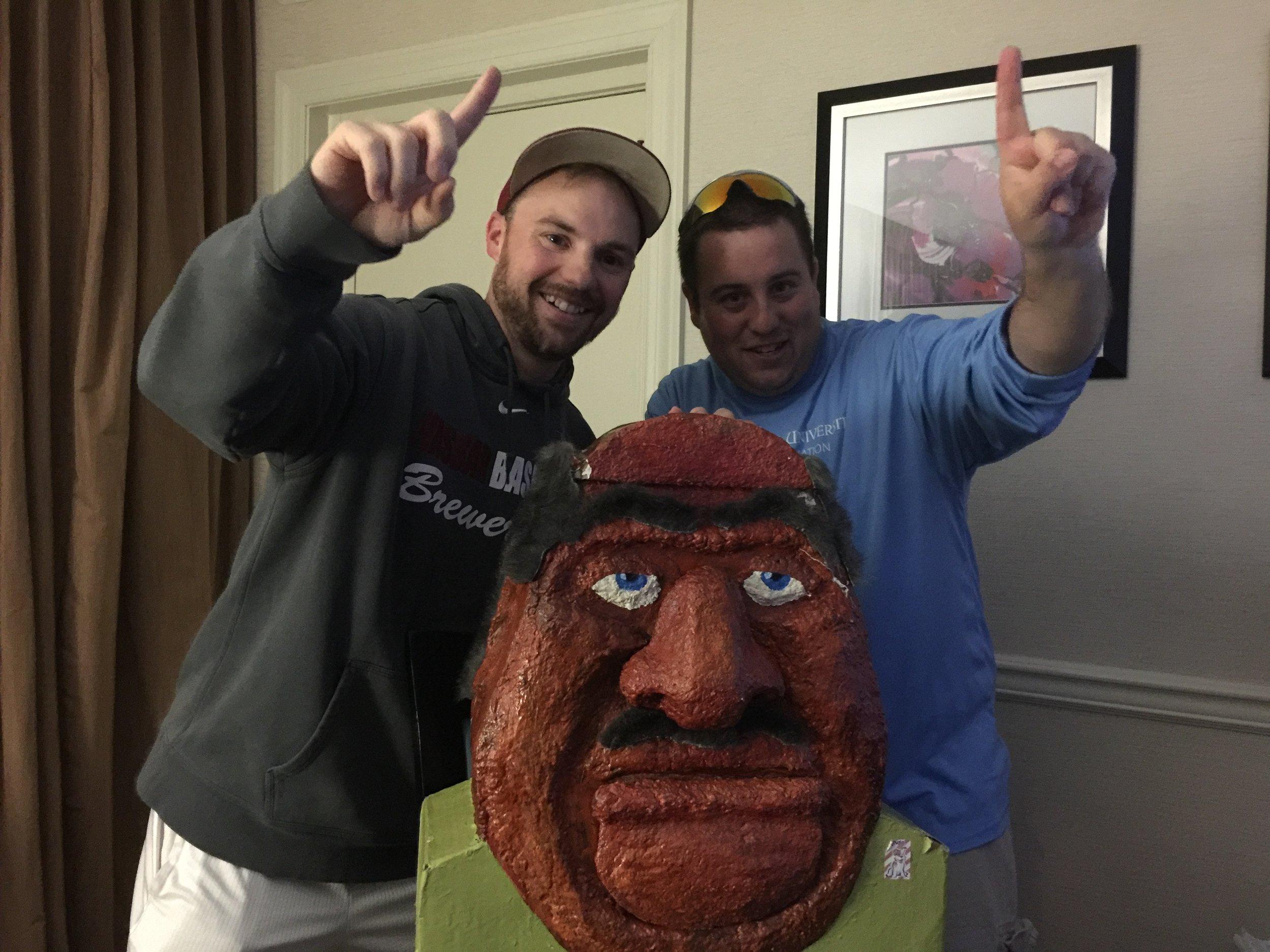 Chagnon (left) and Morgal (right) celebrate with Big Head.