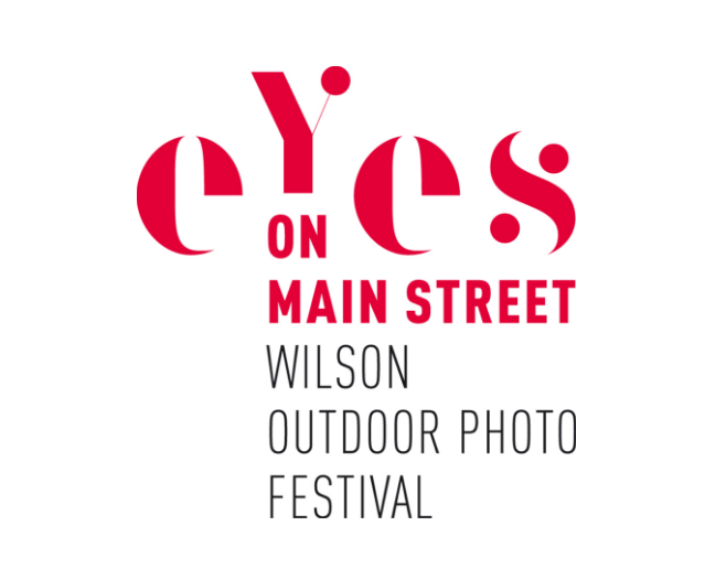 "Last year I helped with the student gallery and workshops for the kids of Wilson to create an exhibition of their work. This year I was asked to be one of the 100 participating artists in the Eyes on Main Street Wilson Outdoor Photo Festival. My photograph ""Jamie, Jody, and Aiden, 2014"" was selected this year and was on exhibit in downtown Wilson, NC from April until August. I will have work from my NoShow series in next years festival."