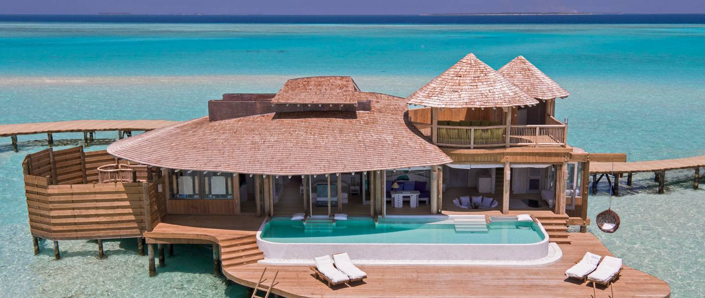One of Soneva Jani's incredible Water Retreat Villa's, which includes a private pool, netted hammocks and a waterslide leading straight into the crystal clear waters below.