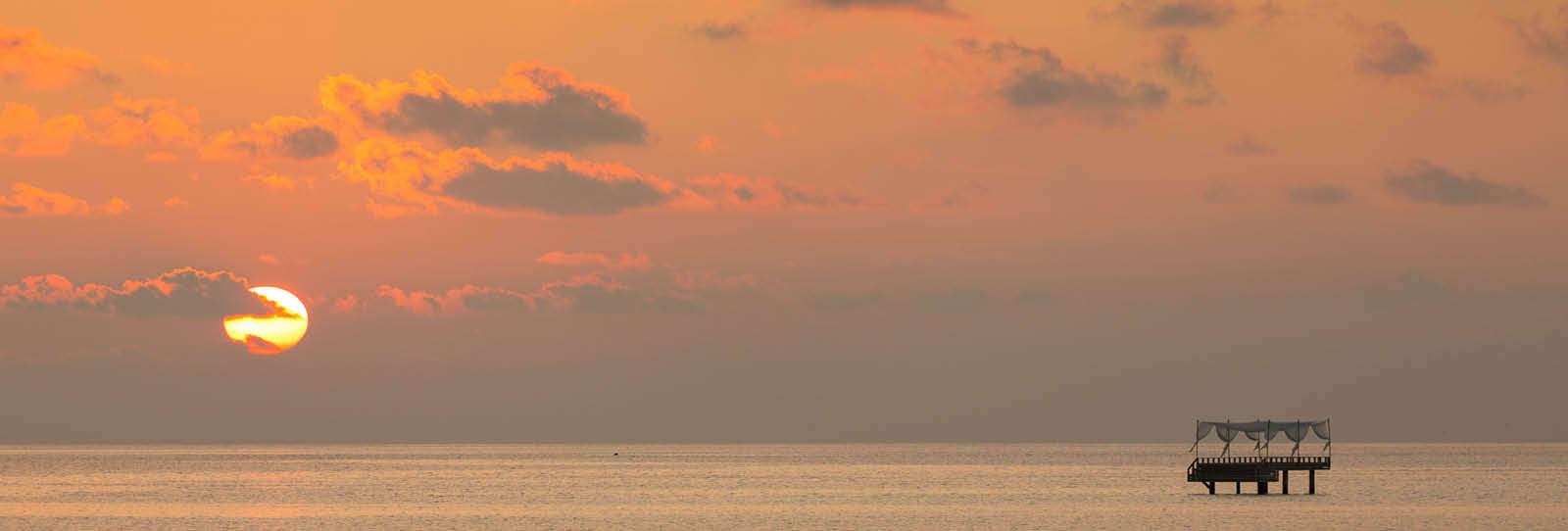A gorgeous Maldivian sunset beyond the Baros Piano Deck.