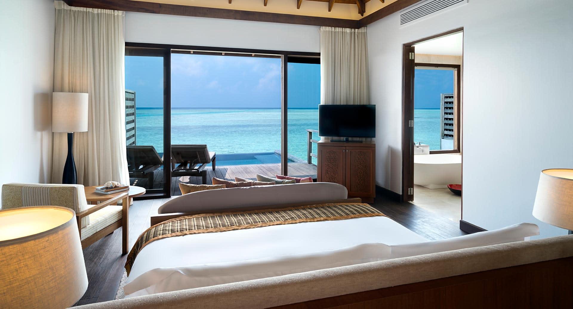 anantara_veli_maldives_deluxe_over_water_pool_bungalow_bedroom_01_1920x1037.jpg