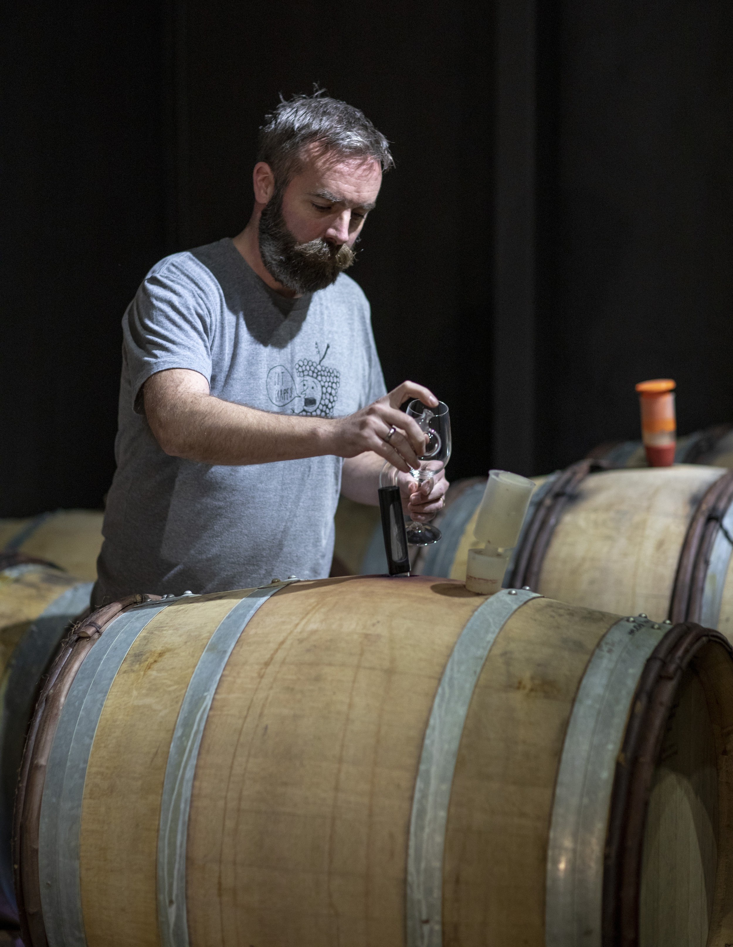 Keith tasting the barrels