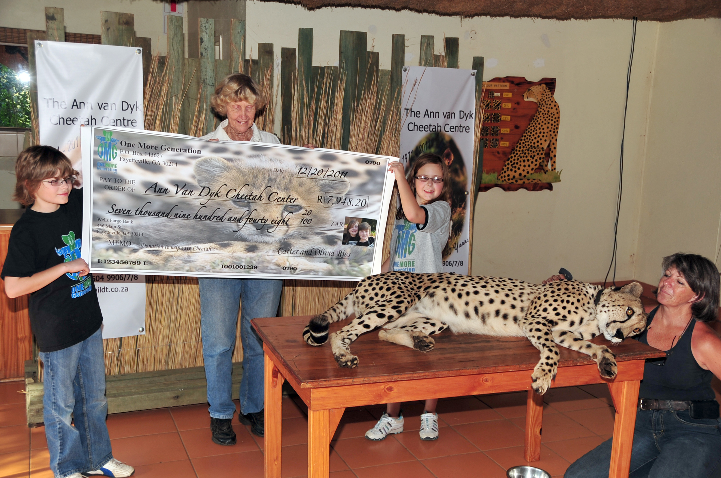 Delivering a check to help with cheetah rescue efforts