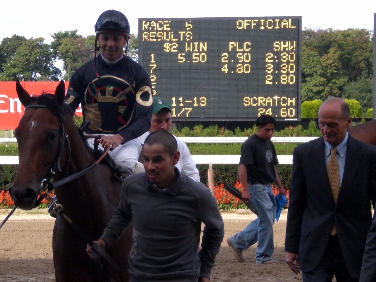 Trainer Barclay Tagg with Cute Cognac and Jockey to Winner's Circle.JPG