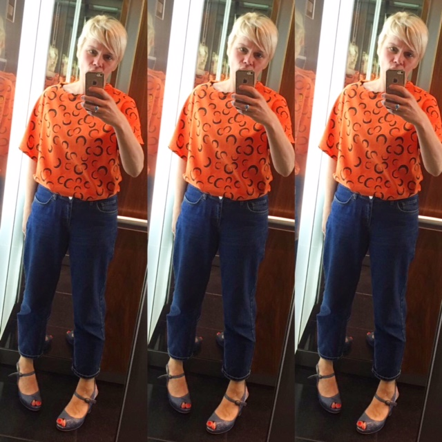 Trudi in her Orange Eclipse Neat Top