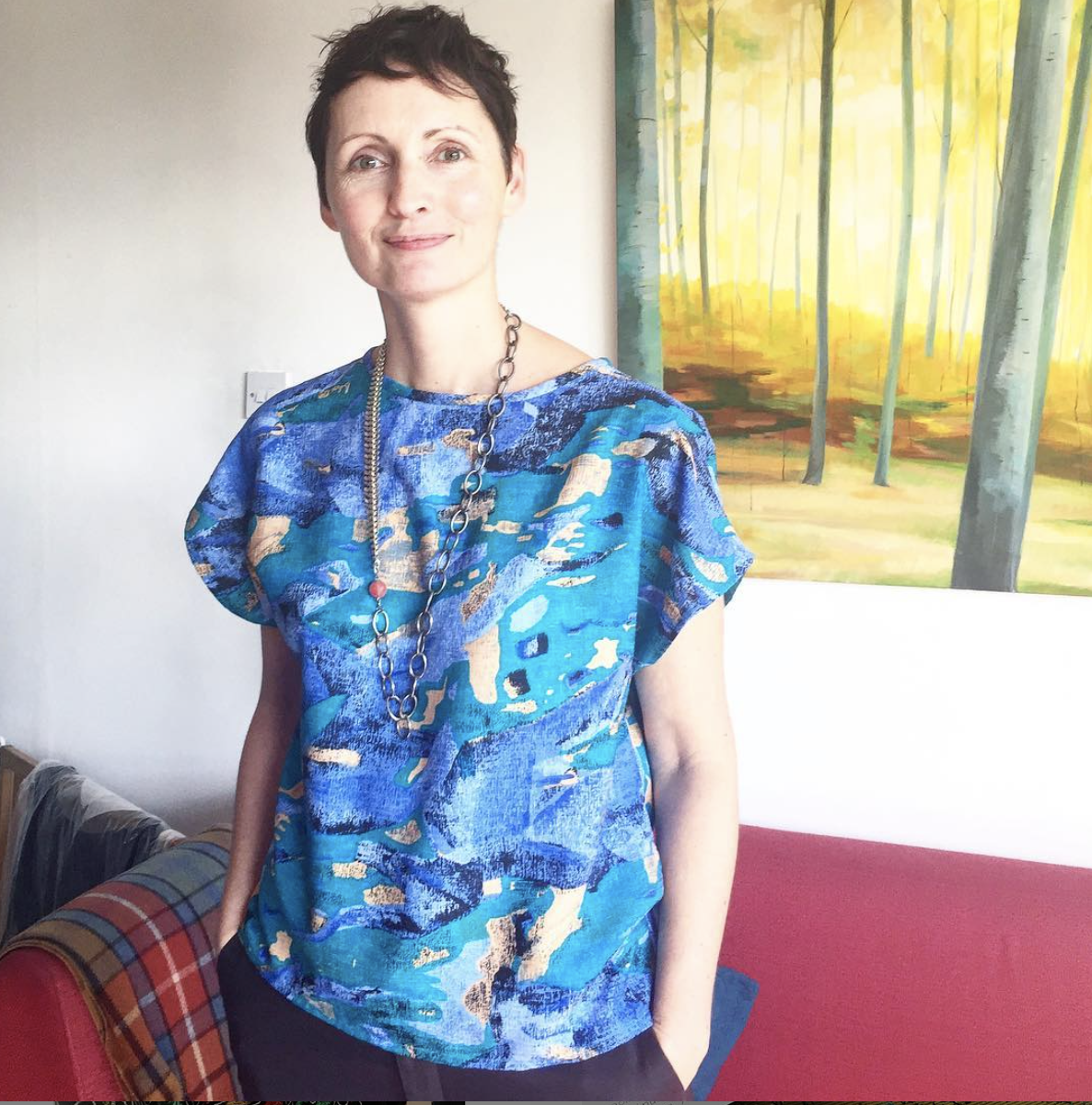 Brigitte of @twistedvintagejewellery in her Painterly View Neat Top with cap sleeves