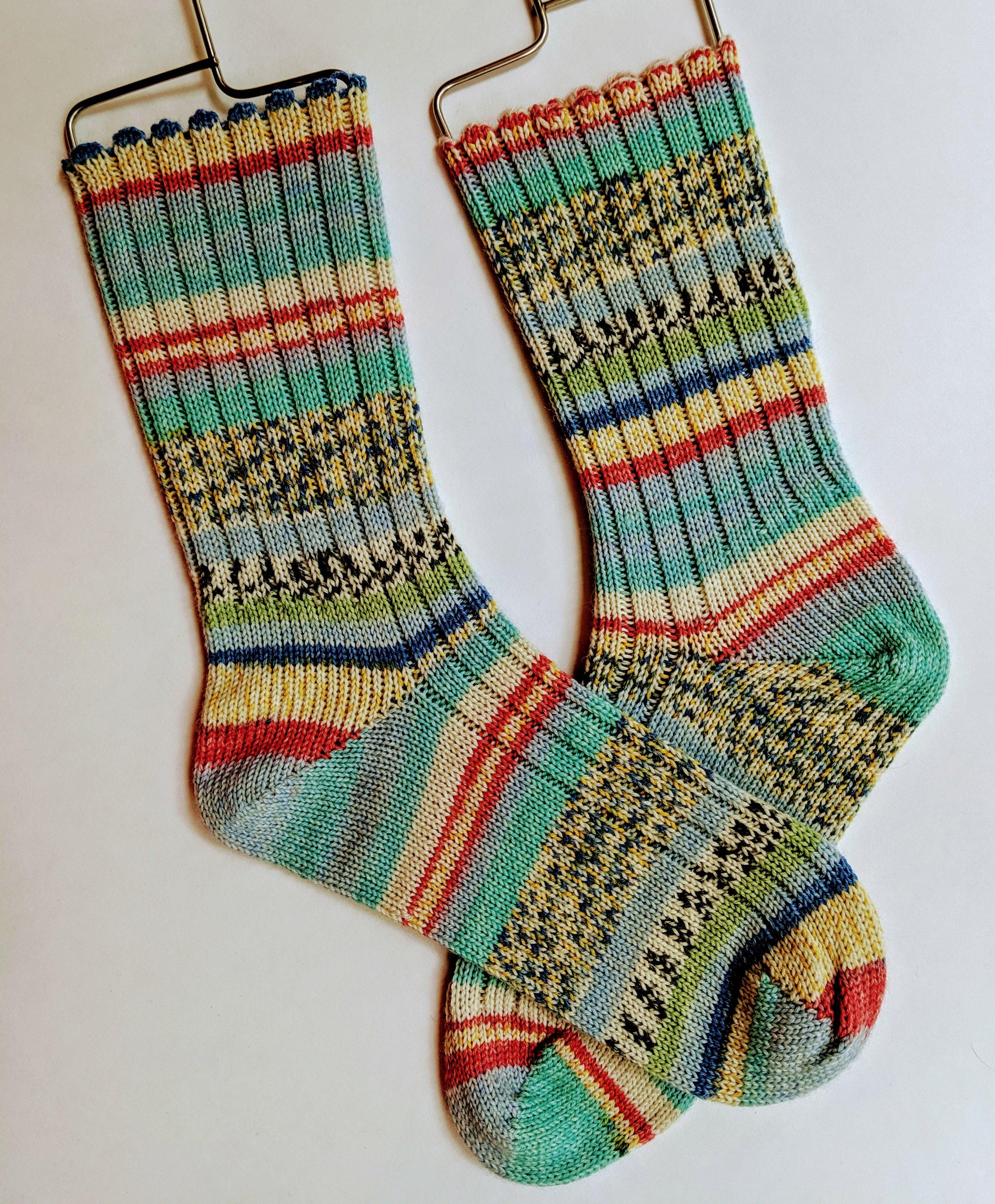 Random stripe ribbed socks; wool and nylon