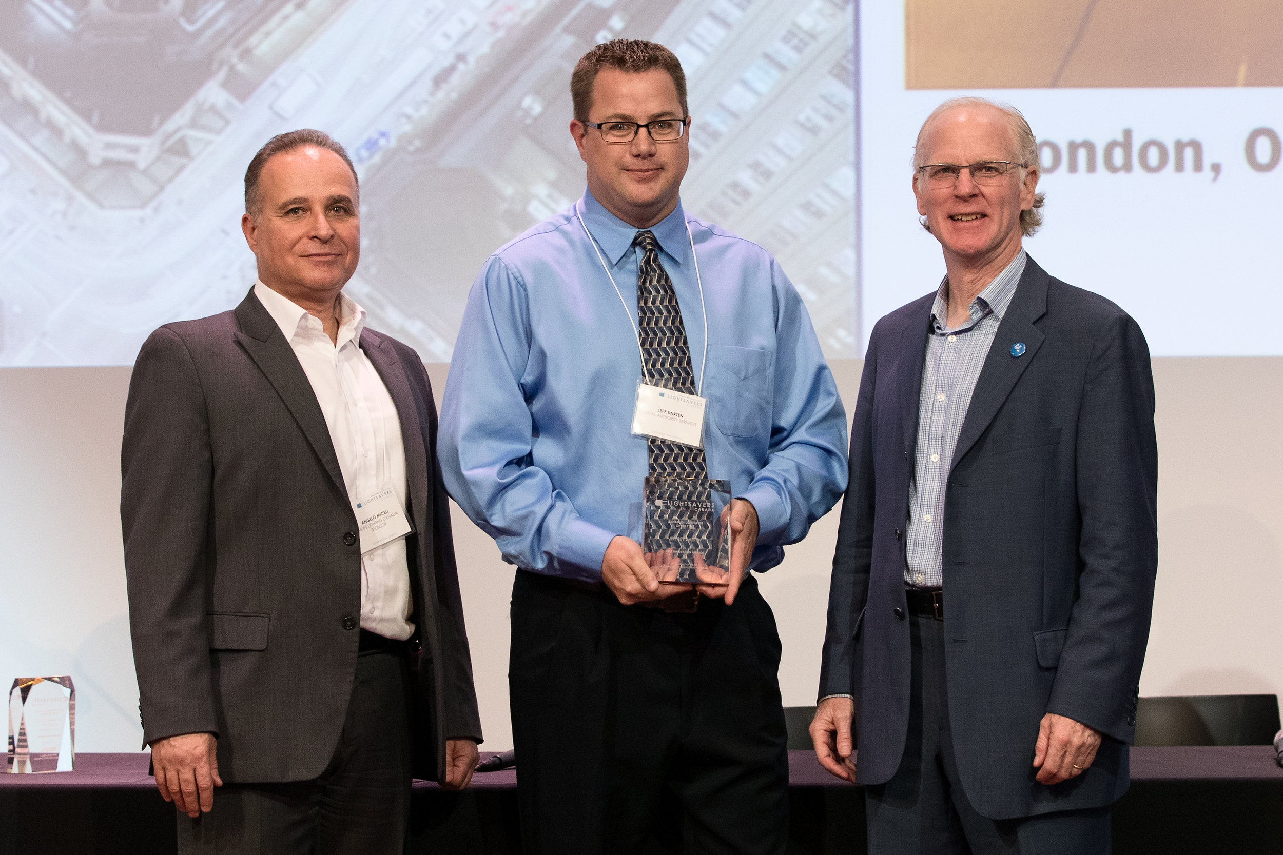 Jeffrey Barten  accepting the award with Peter Halsall and Angelo Miceli.
