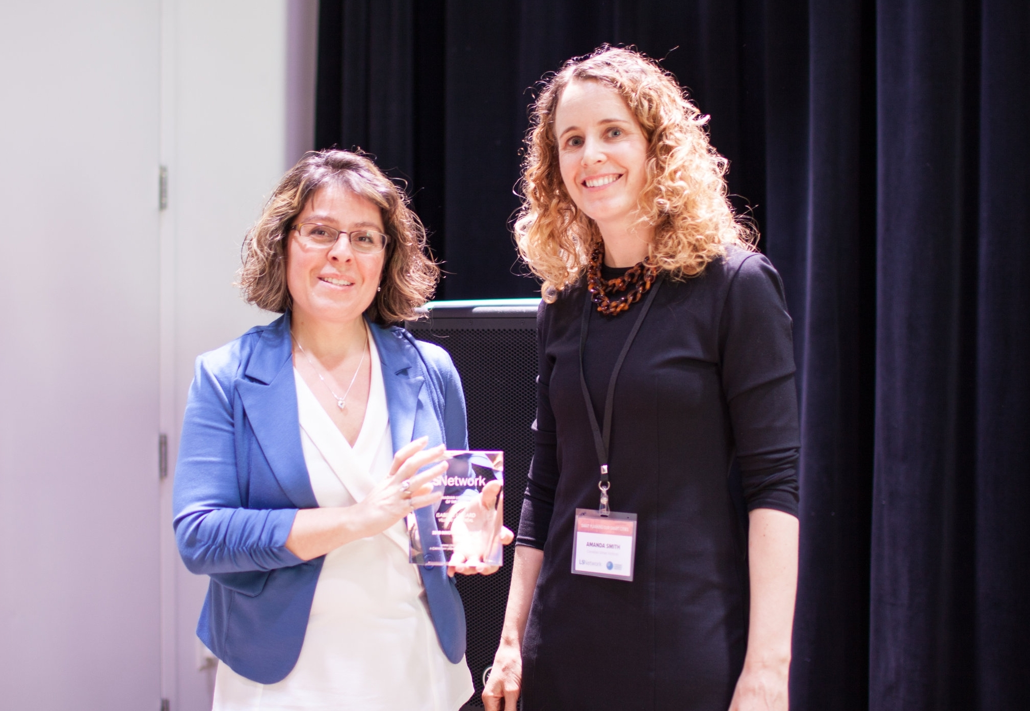 Isabelle Lessard accepting the award with Amanda Smith of LSNetwork.