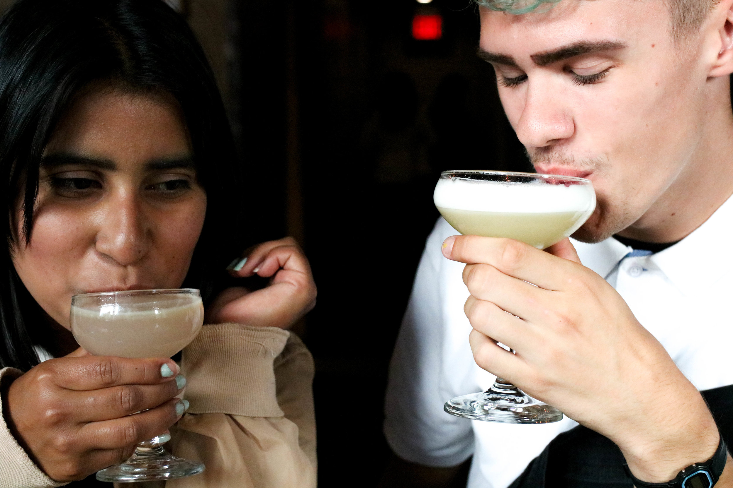 Our guest services team lead Natalie and our inventory coordinator Adam enjoying their favourite Proof Cocktails.